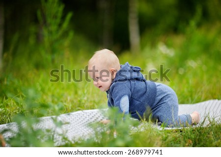 Outdoors portrait of crawling baby boy  - stock photo