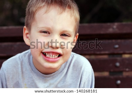Outdoors portrait of cute 5 years old child boy - stock photo