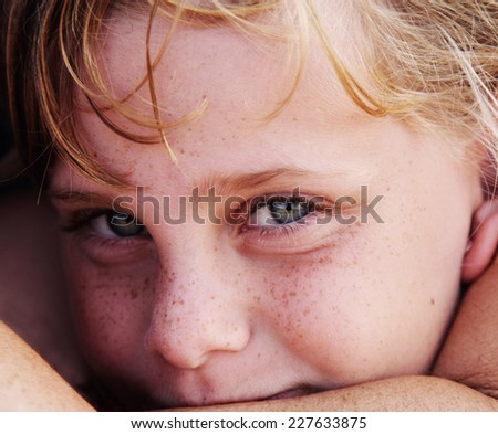 outdoors portrait of freckled cute girl - stock photo