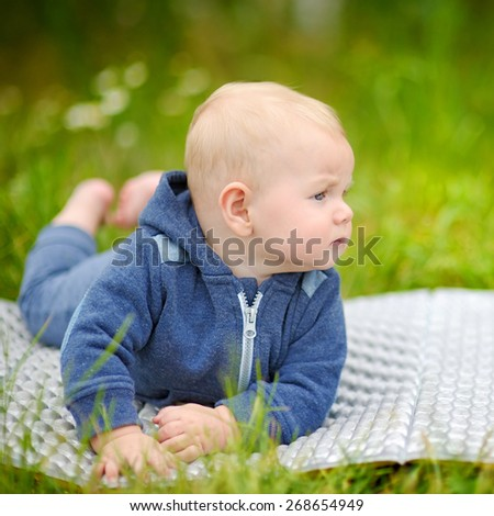 Outdoors portrait of little baby boy  - stock photo