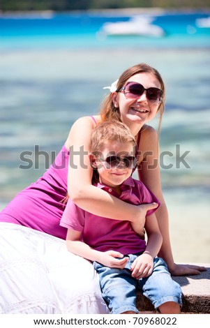 Outdoors portrait of mother and son at sunny summer day
