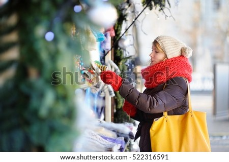 Outdoors portrait of young beautiful woman on a Christmas market
