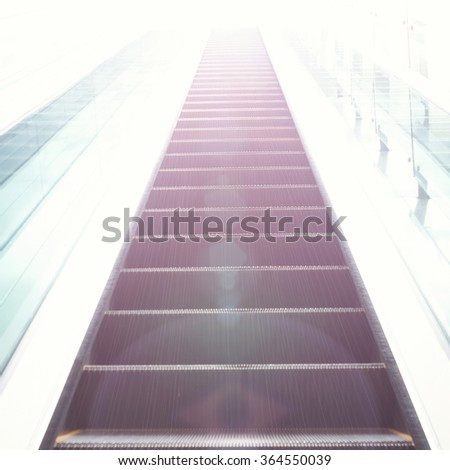 Outdoors shoot of escalator's stairs as a concept of successful elevation - stock photo