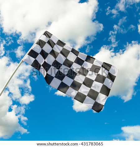 Outdoors shot of a checkered flag waving in the wind series - stock photo