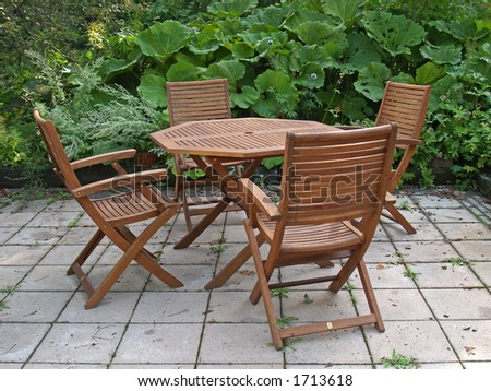Outdoors table and four chairs, close-up - stock photo