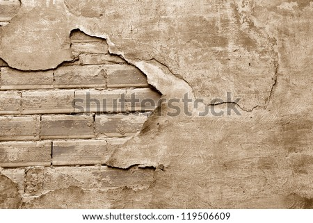 outer wall of the ruined house with plaster - stock photo