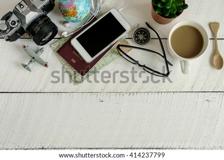 Outfit of traveler on white wooden background and copy space, Travel concept - stock photo