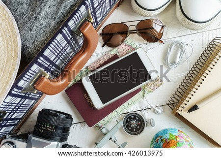 Outfit of traveler on white wooden background, Travel concept - stock photo