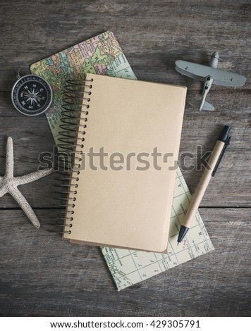 Outfit of traveler on wooden background and copy space, Travel concept - stock photo