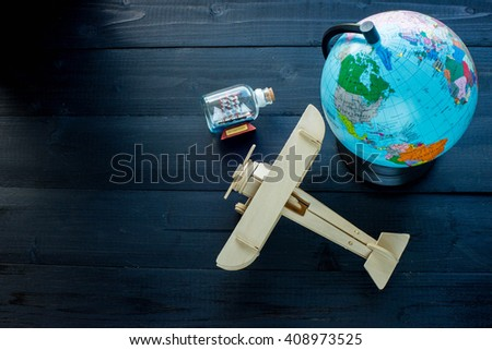 Outfit of traveler on wooden background and copy space, Vintage tone, Travel concept - stock photo