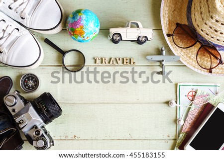 Outfits and accessories of traveler on green background with copy space, Travel concept - stock photo