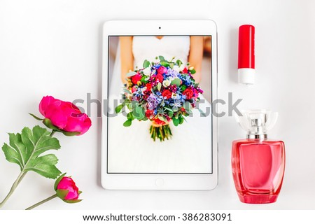 Outfits or set of modern young girl, student, woman, hipster. Overhead of essentials on white background:, laptop, pomade, flower, perfume, pad, tablet - stock photo