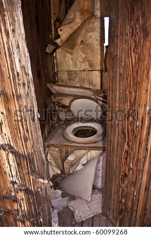 Outhouse- An old outhouse from Berlin, Nevada, a ghost town in Berlin, Ichthyosaur outside of Reno - stock photo