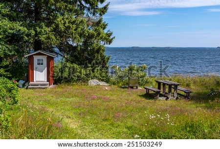 Outhouse and sea - stock photo
