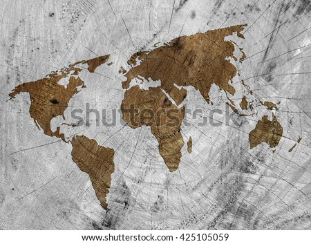 Outline map of world on sawn tree stump.