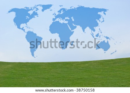 Outline of world map in blue sky above green grass - stock photo