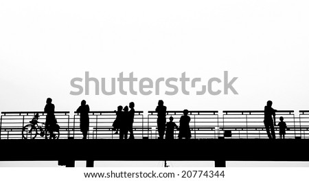 Outline silhouette of pedestrians on a bridge - stock photo