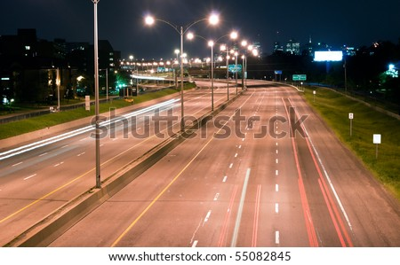 Outline Trail light passing  on the Highway at night - stock photo
