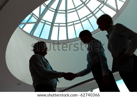 Outlines of business people making agreement in the office - stock photo