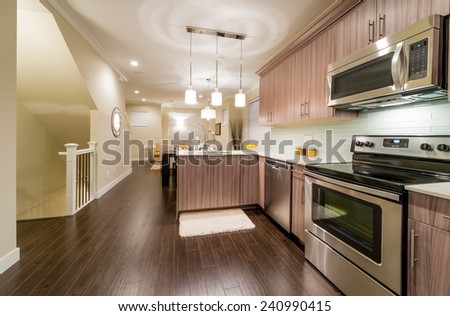Outlook at the luxury modern living suite : kitchen and living room, dining room at the back.  Interior design. - stock photo