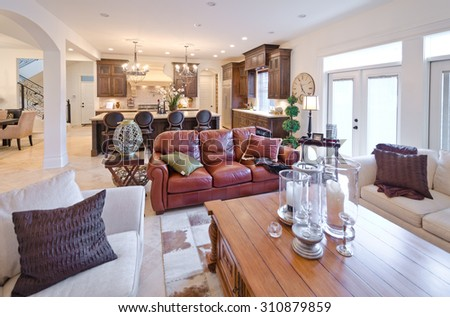Outlook, panorama at the luxury living suite: living room and the kitchen and dining room at the back. Interior design. - stock photo