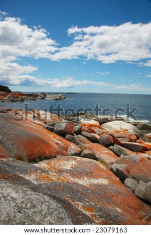 outlook to ocean from rocky ledge - stock photo
