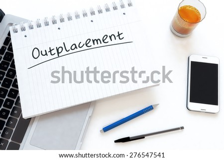 Outplacement - handwritten text in a notebook on a desk - 3d render illustration. - stock photo