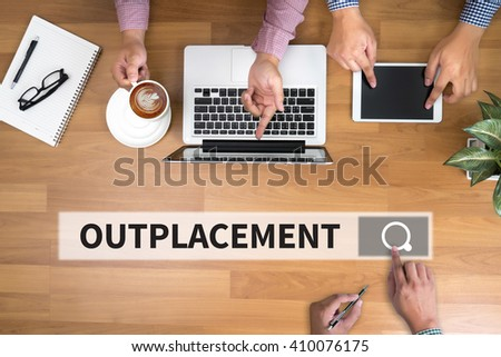 OUTPLACEMENT man touch bar search and Two Businessman working at office desk and using a digital touch screen tablet and use computer objects on the right, top view - stock photo