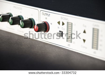 Output knob in professional audio equipment - stock photo