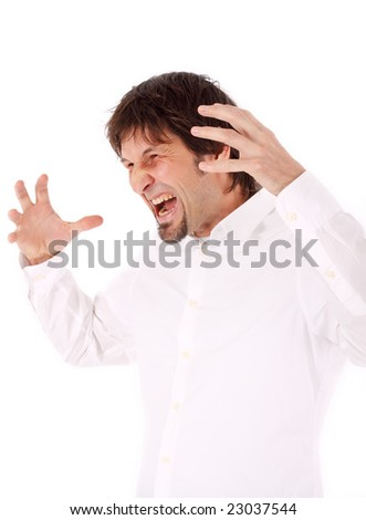 outraged businessman screaming and pointing his hands towards his head - stock photo