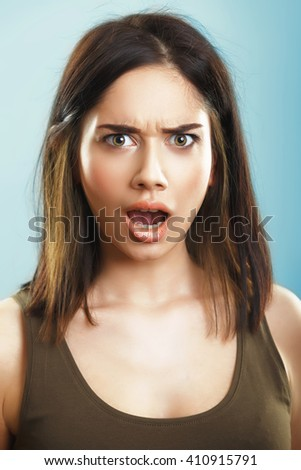 outraged offended young woman - stock photo