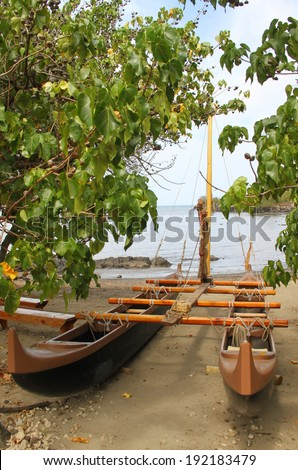Outrigger canoe on beach at Pu'ukohola Heiau National Historic Site - stock photo