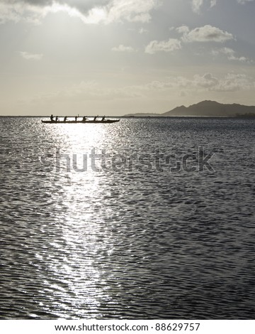 Outrigger canoe paddling in Hawaii - stock photo
