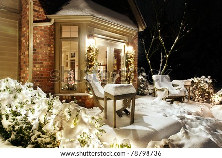 Outside Christmas lights on a snowy evening - stock photo