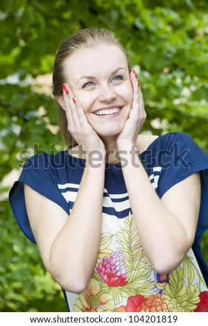 outside close-up portrait of beautiful young happy woman with fresh and clean skin - stock photo