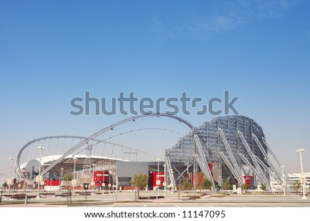 Outside Khalifa sports stadium in Doha, Qatar, Middle East, where the 2006 Asian games were hosted and location for the proposed 2016 Olympic Games (wide angle lens distortion on edges) HDR Image - stock photo