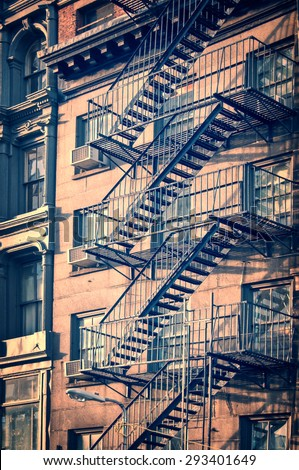 Outside metal fire escape stairs, New York City, vintage process - stock photo