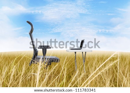 Outside office in a golden grass with a clear blue sky - stock photo