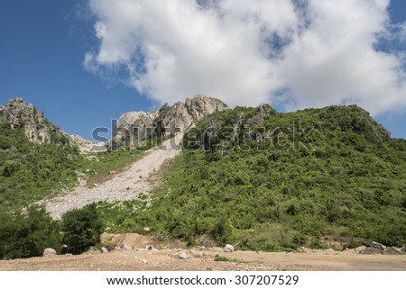 Outside perspective of limestone mining - stock photo