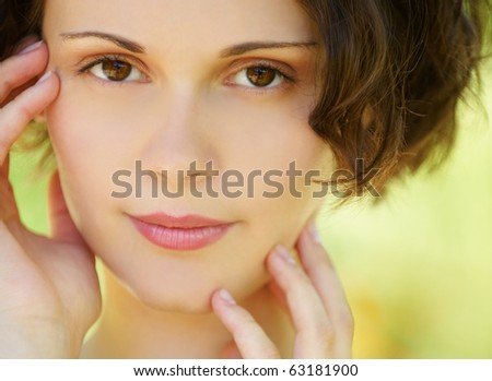 outside portrait of young beautiful brunette woman with fresh and clean skin - stock photo
