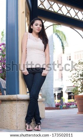 Outside shoot with model wearing peach colored tank top - stock photo