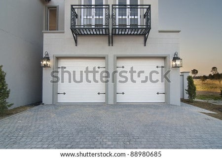 Outside shot, showing the garage and portion of a modern house - stock photo