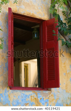 Outside shuttered window looking into room - stock photo