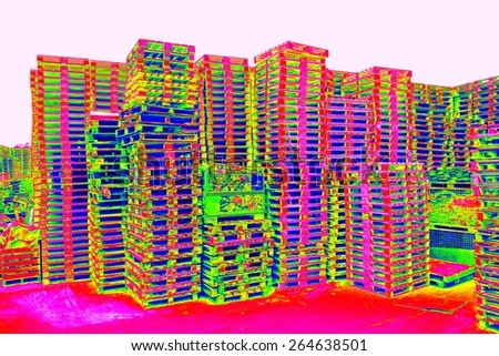 Outside stock of old manufactured wooden euro pallets  in thermography scan. - stock photo
