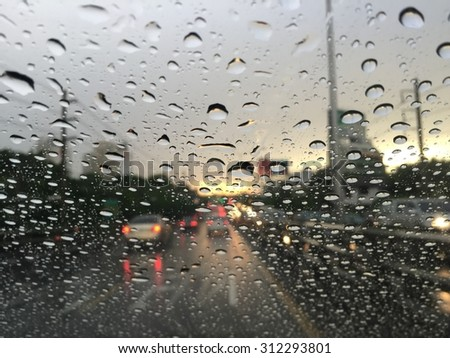 Outside the car in the rain day. Very Traffic jam  - stock photo