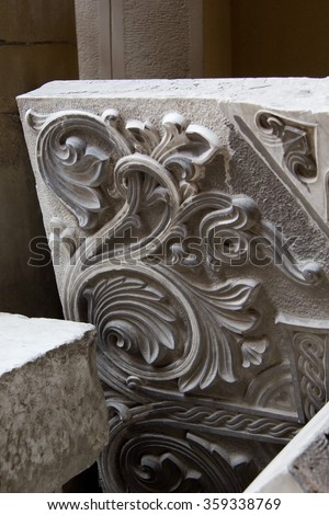 Outside the historical building of The Armenian Cathedral of the Assumption of Mary. Old stone slabs - stock photo