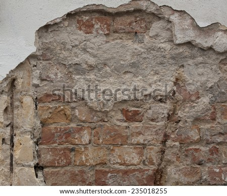 Outside wall of old buildings, made from bricks and mortar, decaying over a long time. Grunge background. - stock photo