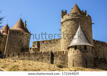 Outside walls of Porte Narbonnaise at Carcassonne in France - stock photo