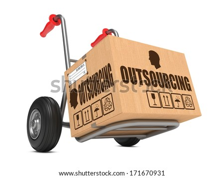 Outsourcing - Cardboard Box on Hand Truck Isolated on White Background. - stock photo
