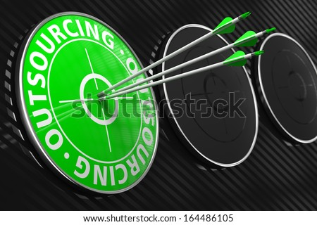 Outsourcing Concept. Three Arrows Hitting the Center of Green Target on Black Background. - stock photo